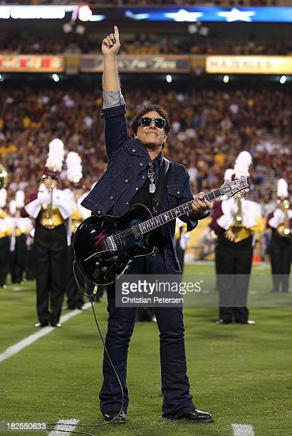 Neal Schon of Journey performs the National Anthem before the college football game between the Arizona State Sun Devils and the USC Trojans at Sun...