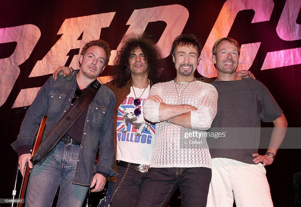 Neal Schon (Ex-Journey member), Slash of Guns N' Roses, Paul Rodgers of Bad Company, and Simon Kirke of Bad Company pose for pictures during a break at the sound check prior to the concert.