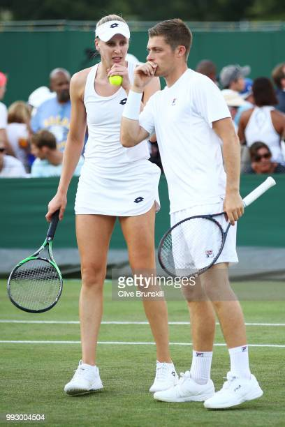 Neal Skupski and Naomi Broady of Great Britain talk against Joe Salisbury and Katy Dunne of Great Britain during their Mixed Doubles first round...