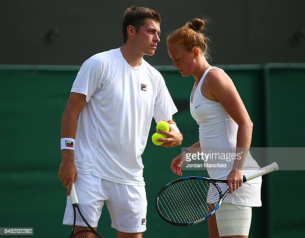Neal Skupski of Great Britain and Anna Smith of Great Britain in conversation during the Men's Doubles third round match against Aisam Qureshi of...