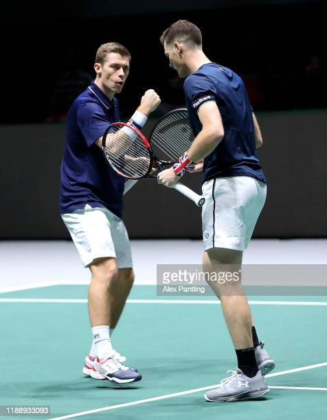 Neal Skupski of Great Britain and his playing partner Jamie Murray celebrate together during their Davis Cup Group Stage match against Wesley Koolhof...