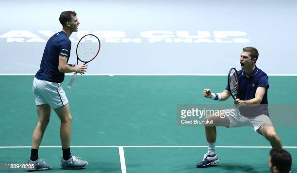Neal Skupski of Great Britain and his playing partner Jamie Murray celebrate match point during their Davis Cup Group Stage match against Wesley...