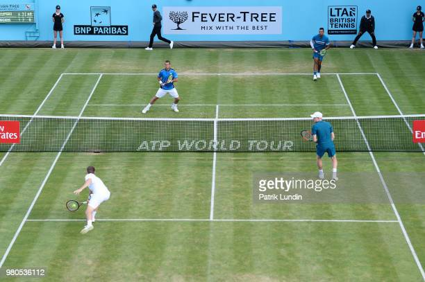 Neal Skupski of Great Britain hits a backhand during the doubles match against Lleyton Hewitt of Australia and Nick Kyrgios of Australia while...