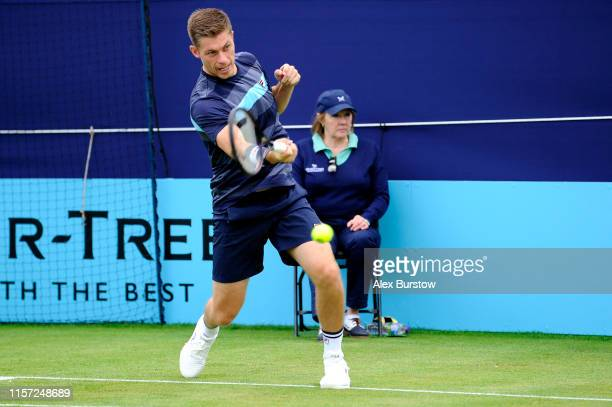 Neal Skupski of Great Britain partner of Jamie Murray of Great Britain plays a forehand during his First Round Doubles Match against Nicolas Mahut...
