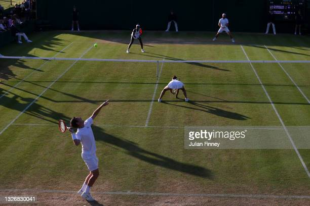 Neal Skupski of Great Britain serves alongside his partner Desirae Krawczyk of United States during their mixed doubles second round match against...