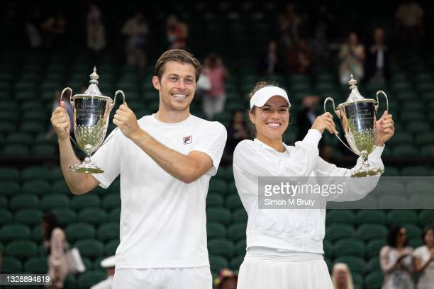 Neal Skupski of United Kingdom and Desirae Krawczyk of USA with the winners trophies after victory in the Mixed Doubles Final against Harriet Dart...