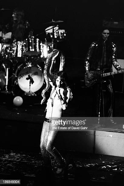 Neal Smith Alice Cooper and Dennis Dunaway of the rock group Alice Cooper perform in November 1972 at Hofstra University in New York City New York