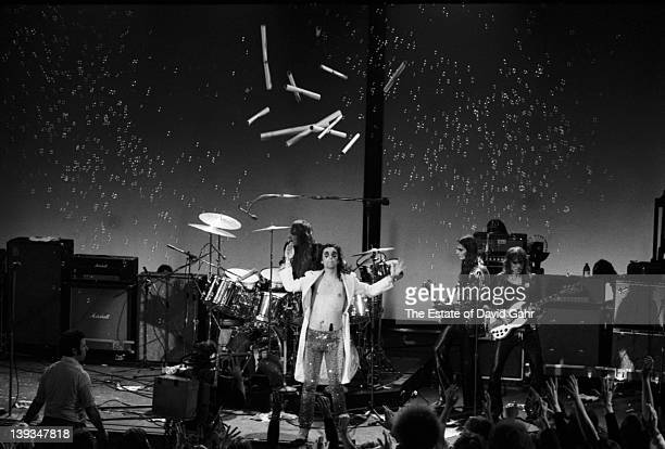 Neal Smith Alice Cooper Dennis Dunaway and Glen Buxton of the rock group Alice Cooper perform in November 1972 at Hofstra University in New York City...