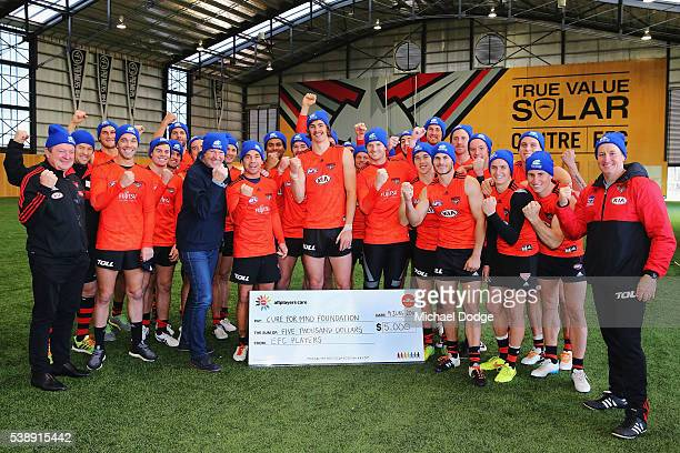Neale Daniher and the Bombers team pose during an Essendon Bombers AFL media and training session at True Value Solar Centre on June 9 2016 in...