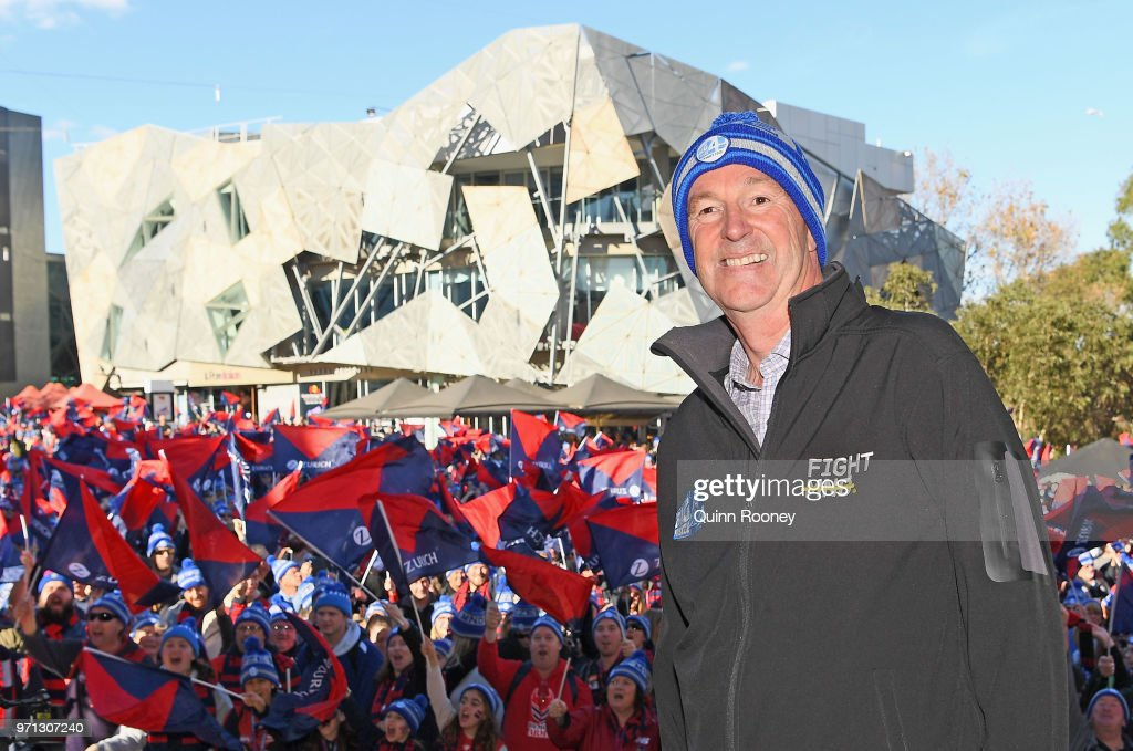 Neale Daniher poses at Federation Square before walking to the MCG during the round 12 AFL match between the Melbourne Demons and the Collingwood Magpies at Melbourne Cricket Ground on June 11, 2018 in Melbourne, Australia.
