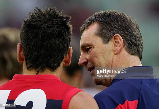 Neale Daniher speaks with Adem Yze of the Demons during the round seven AFL match between the Melbourne Demons and the Fremantle Dockers at the...