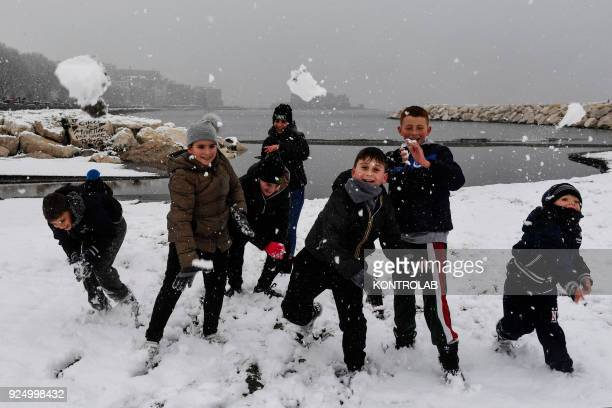 Neapolitan children play during the extraordinary snowfall that has whitened the city Bad weather comes from the Siberian region and has been called...