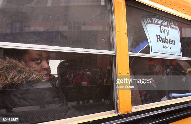 Near a poster bearing the name of a murdered student a student stares out the window of a school bus following an antiviolence rally in the Loop...