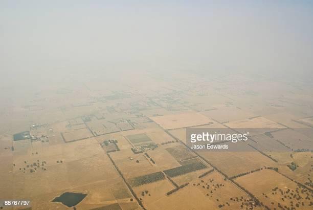 Smoke from vast bushfires shrouds farmland during a blistering summer.