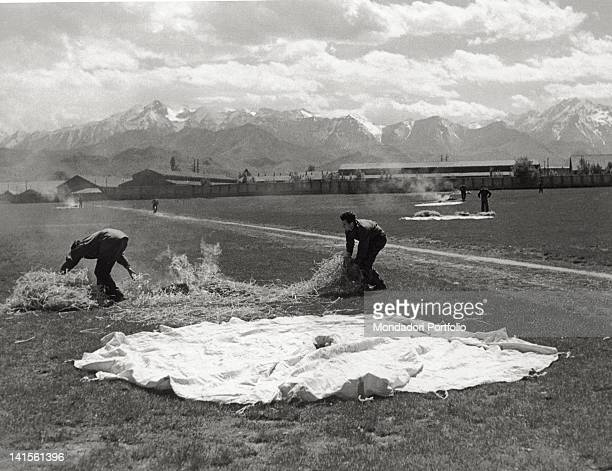 Near Cuneo once they have detected the aircraft supplying provisions some partisans set fire to piles of straw next to the signalling sheets to...