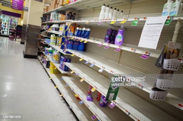 Near empty shelves for detergent are seen in a supermarket in Washington, DC on March 20, 2020. - The coronavirus outbreak has transformed the US...