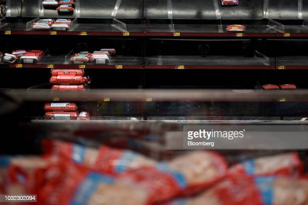 Near empty shelves stand in the meat aisle at a Walmart Inc store ahead of Hurricane Florence in Greenville North Carolina US on Wednesday Sept 12...