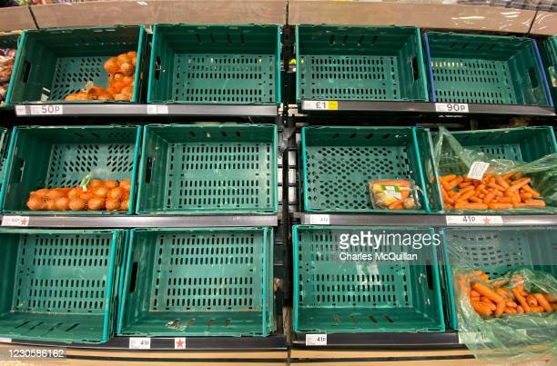 Near empty vegtable shelf section in Sainsburys on January 14, 2021 in Belfast, Northern Ireland. Supermarkets here are already seeing disruption to...