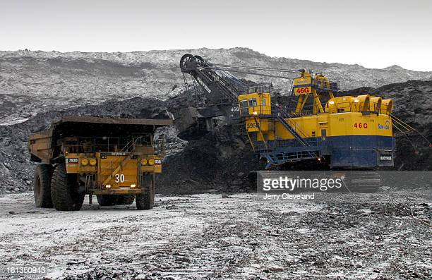 NOVEMBER 3 2003 Near Fort McMurray Alberta Canada A Caterpiller <cq> 797 mining truck begins to back into position to be loaded with oil sands by a...