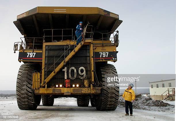 NOVEMBER 3 2003 Near Fort McMurray Alberta Canada Doug Demerais <cq> right a heavy equipment operator at Suncor Energy Inc's <cq> oil sands mine and...