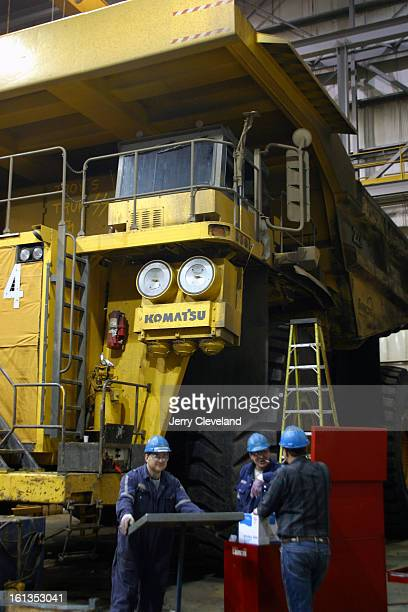 NOVEMBER 3 2003 Near Fort McMurray Alberta Canada Maintenance workers stand near a 360ton Caterpiller 797 mining truck in a heated shop at Suncor...