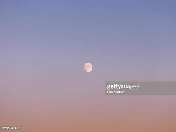 near full moon in tranquil dusk sky - alpes maritimes stock pictures, royalty-free photos & images