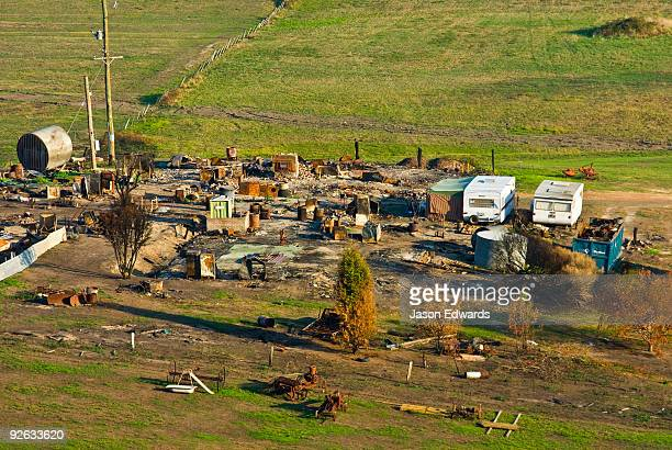 An aerial view of a farming property destroyed by a forest fire.