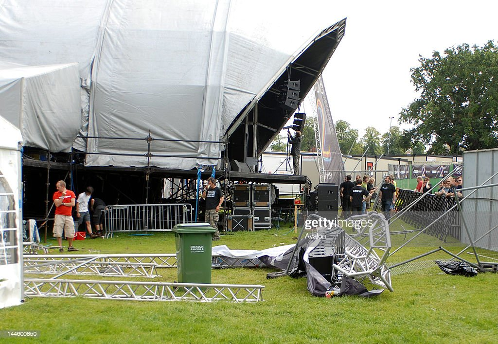Near miss at Guilfest, a Speaker tower is blown over by the wind