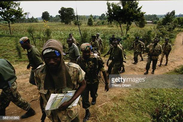 Near Ruhengeri a Rwandan army patrol unit leaves the combat zone for Gisenyi where what is left of the government will settle into the Meridien Hotel...