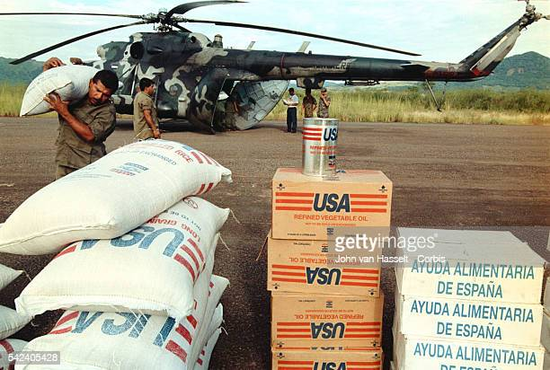 Near San Ramon troops unload food aid from the USA and Spain
