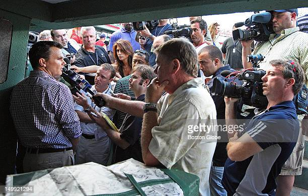 Near the end of Red Sox batting practice team GM Ben Cherington far left held an impromptu session with reporters concerning the fate of manager...