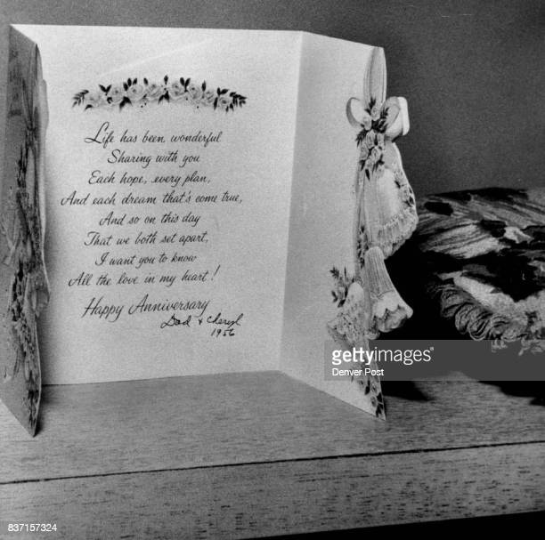 Near the head of Mrs Cannon's bed is this carda wedding anniversary message signed 'Dad and Cheryl 1956' Credit Denver Post