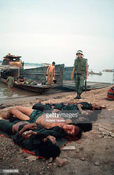 Near the Japanese bridge a couple of weeks before the fall of Phnom Penh soldiers killed in a fight are brought back to their families