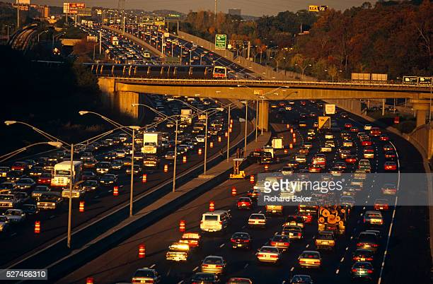Near the junction of the 400 to Buckhead the 401 highway divides and splits during afternoon rushhour traffic which slows and builds up so that...