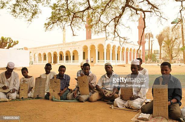 Near the Mahdi's tomb stands a mosque and a Madrassa. I pushed the door to enter, and was welcome to see the students studying Holy Quran and writing...