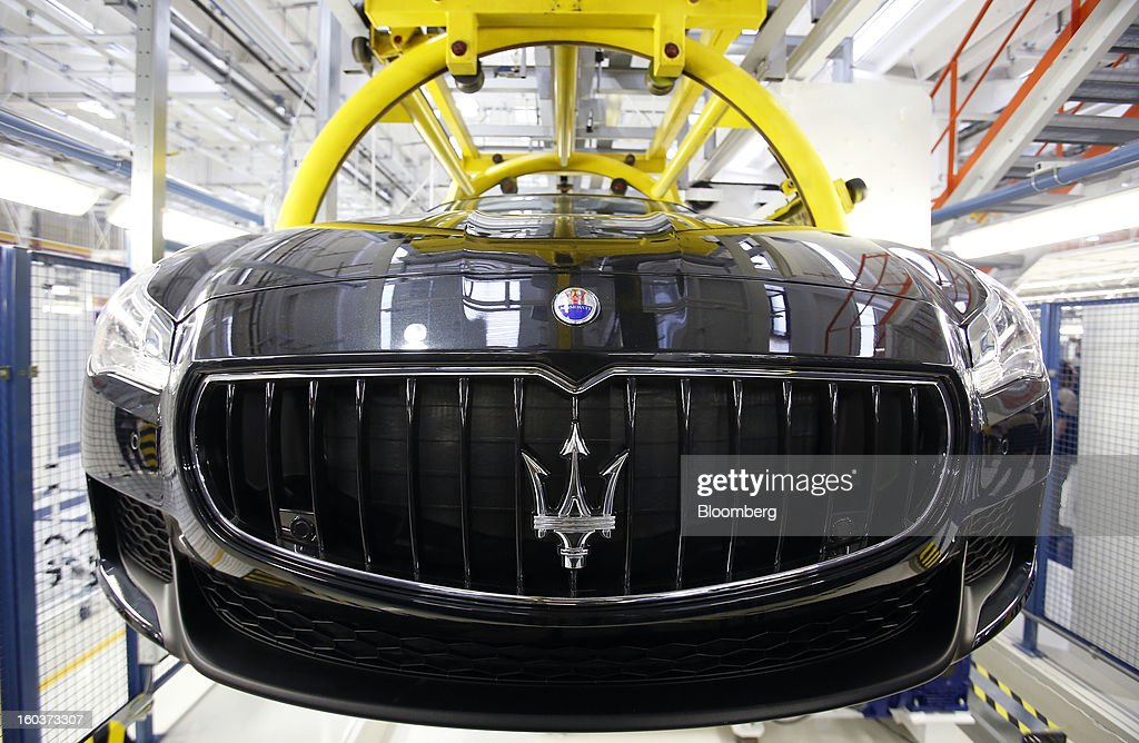 A near-complete Maserati Quattroporte luxury automobile travels along the production line at Fiat SpA's Grugliasco factory in Turin, Italy, on Wednesday, Jan. 30, 2013. Fiat SpA Chief Executive Officer Sergio Marchionne said the Italian carmaker narrowed losses in Europe in the fourth quarter, helping it achieve full-year earnings that were in line with its forecasts. Photographer: Alessia Pierdomenico/Bloomberg via Getty Images