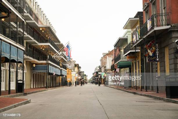A neardeserted Bourbon Street in the French Quarter of New Orleans amid restrictions in place to help deal with the Covid19 pandemic 22nd March 2020