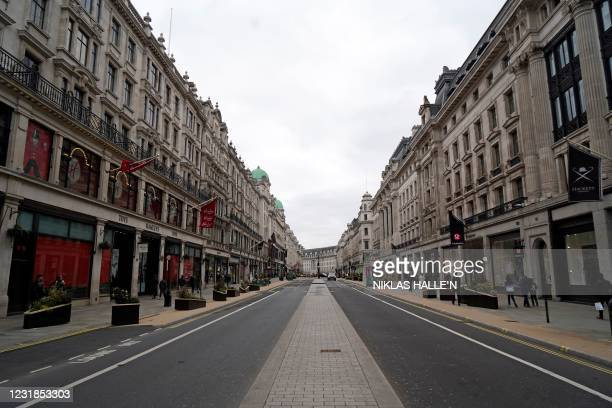 Near-deserted Regent Street is pictured in London on Sunday afternoon, March 21 as the government prepares to gradually lift restrictions following a...