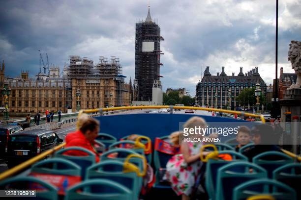 Near-empty open-top tourist tour bus crosses Westminster Bridge in central London on August 24, 2020. - For those tourists who do run the gauntlet of...