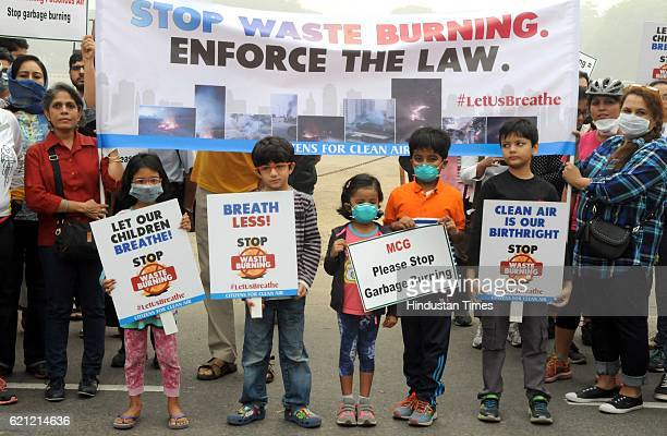 Nearly 300 people and children held a protest against the garbage burning in open area at Leisure Valley Park on November 5 2016 in Gurgaon India...