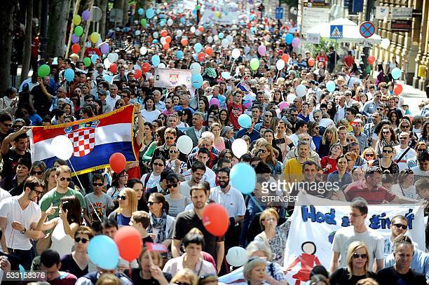 Nearly 3000 people hold placards ballons and a Croatian National flag as they take part in a prolife march in Zagreb on May 21 the first event of...
