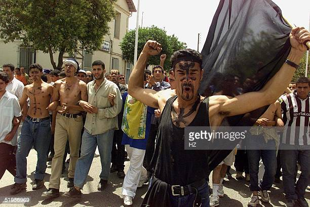 Nearly 30000 people held an antigovernment protest 19 July 2001 in Bouira the third city of the Berber homeland Kabylie in northeast Algeria...
