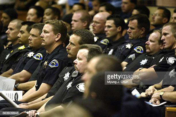 Nearly 450 officers from 26 different agencies gather for a briefing Monday morning before heading out for a parole, probation and gang compliance...
