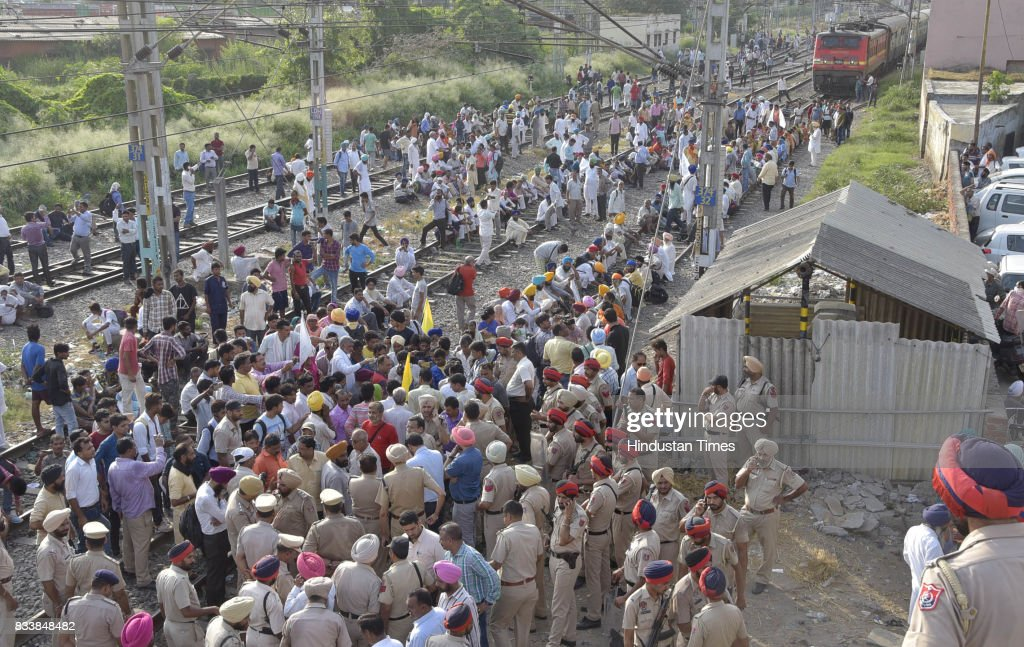 Nearly 500 protesters comprising investors and employees of a chit fund company Pearl Group block railway lines bringing trains to a halt for nearly..