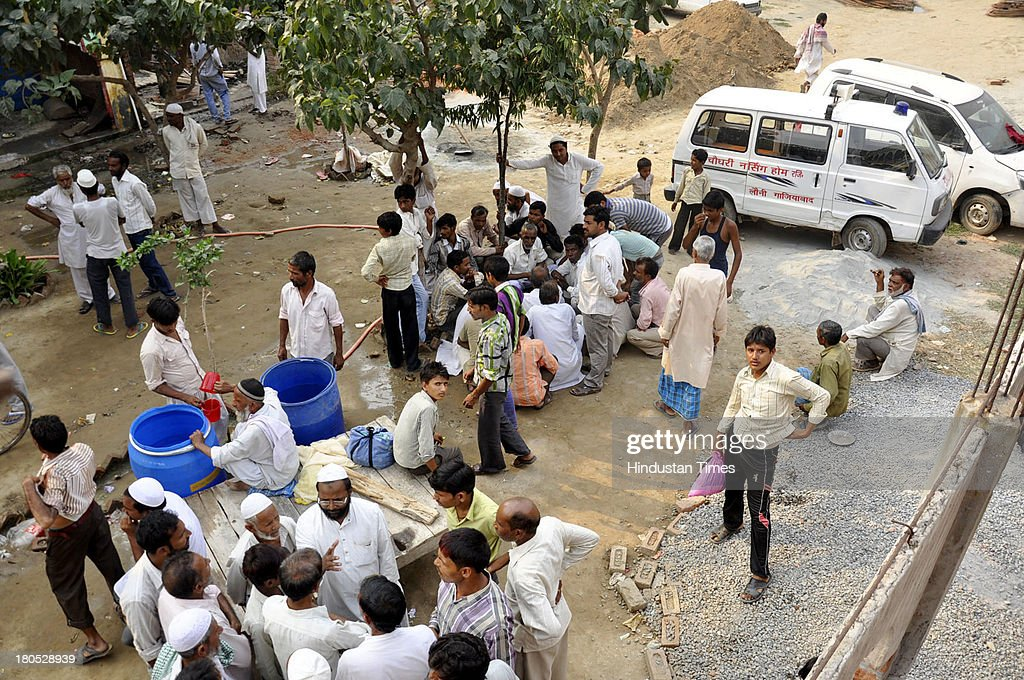Nearly 700 migrants are presently taking shelter and have decided not to return back to their villages at Madarsa, Loni on September 14, 2013 in Ghaziabad, India. Loni town in Ghaziabad witnesses a large influx of migrants from riot-hit Western-UP areas. Women, who suffered most as a result, have slammed politicians and government machinery for the losses and the communal clashes that occured recently in Muzaffarnagar.