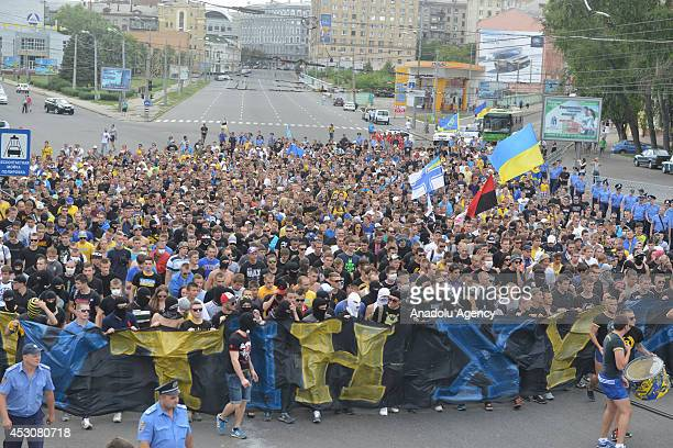 Nearly a thousand fans of Metalist Kharkiv and Dynamo Kyiv stage an antiwar protest for the 'Ukraine's unity' ahead of the football match between...