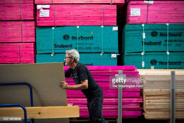 Nearly a year after Hurricane Harvey severely damaged their house David Elliott shops for building supplies at Lowe's Home Improvement in Rosenberg...