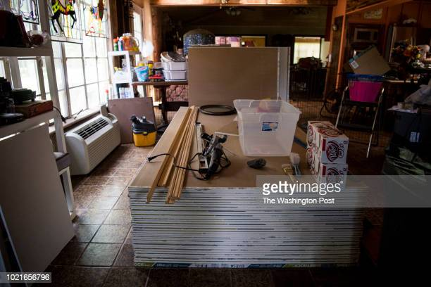 Nearly a year after Hurricane Harvey severely damaged their house building supplies fill Susan and David Elliott's home in Wharton Texas on June 29...