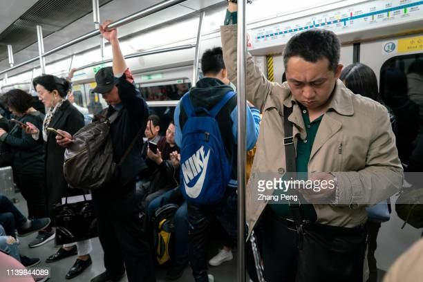 Nearly all passengers are addicted on their mobile phone in subway Over the past 20 years Chinese people's dependence on mobile phones has been...