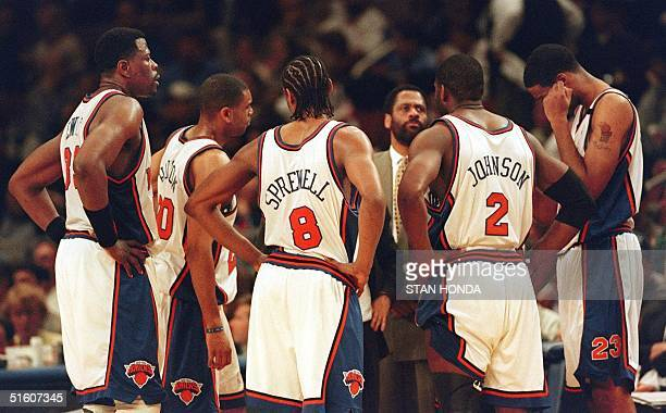 A nearly defeated New York Knicks team meets during a timeout late in the fourth quarter of the fourth game of their Eastern Conference first round...